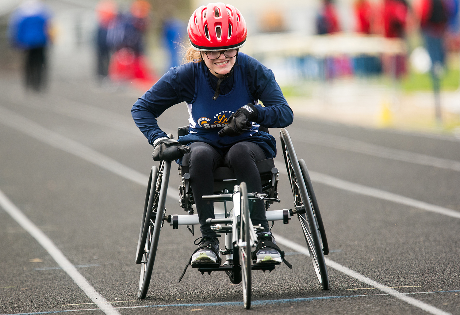 Southeast's Katelyn Koskey competes in the wheelchair 100 meter dash, the first ever at Southeast High School, during the 2019 Thomas McBride Invitational Saturday, April 13, 2019.Ted Schurter/The State Journal-Register