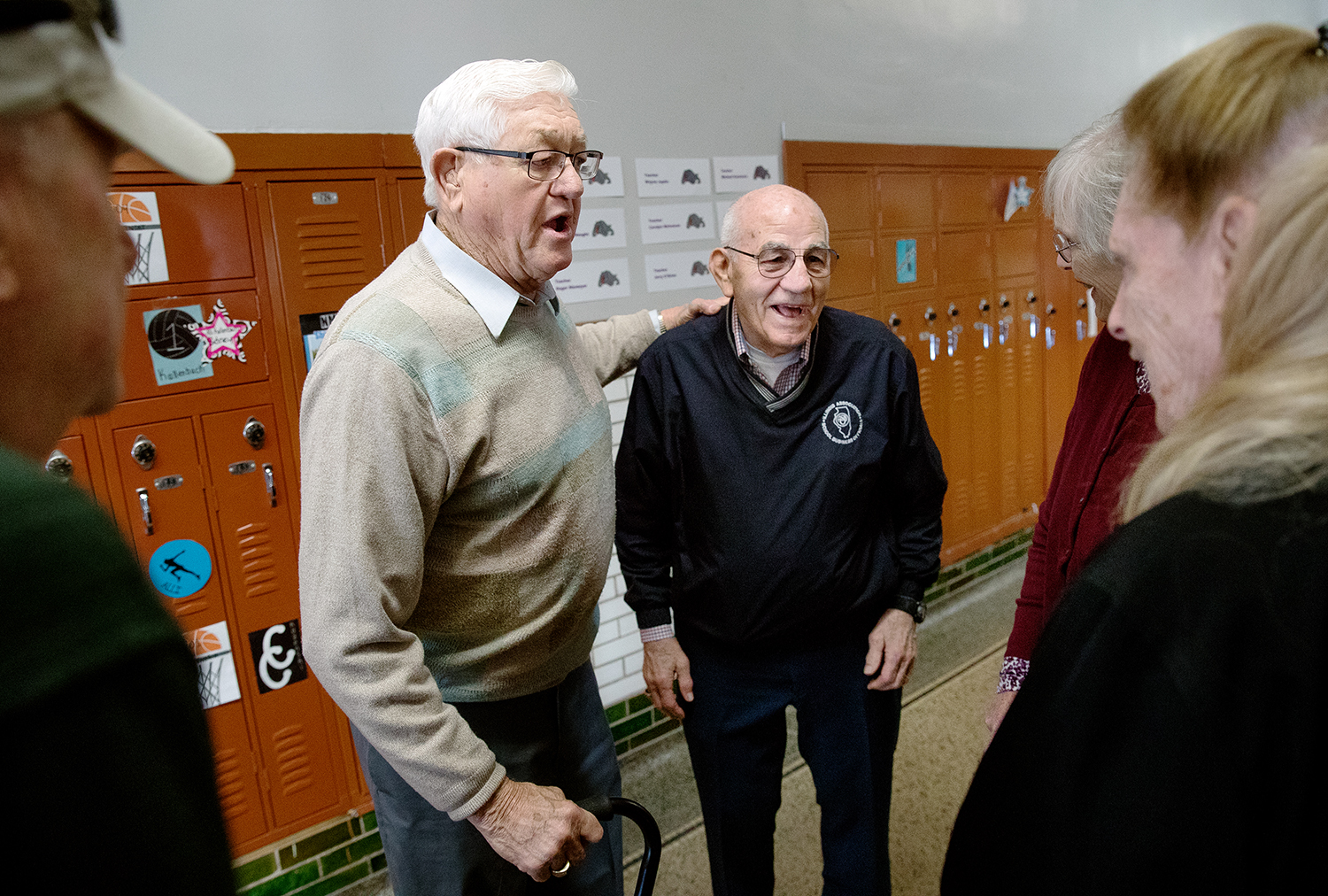Ervin Shores, left, and Calvin Jackson reminisce with friends in the hallways of Virden Community High School during an open house Saturday, April 13, 2019. The old school buildings are being razed to make way for new North Mac High School facilities on the same property. [Ted Schurter/The State Journal-Register]