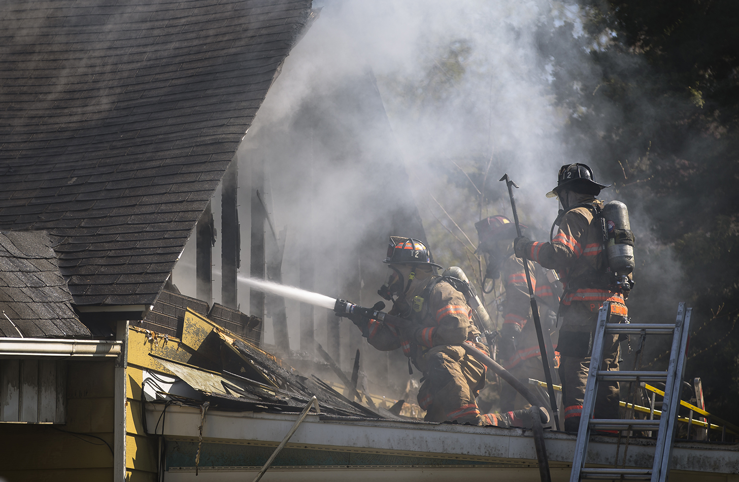 Springfield firefighters attack a structure fire in a residential home in the 2000 block of East Kansas Street, Monday, April 15, 2019, in Springfield, Ill. The home was thought to be vacant and was heavily damaged in the fire. [Justin L. Fowler/The State Journal-Register]