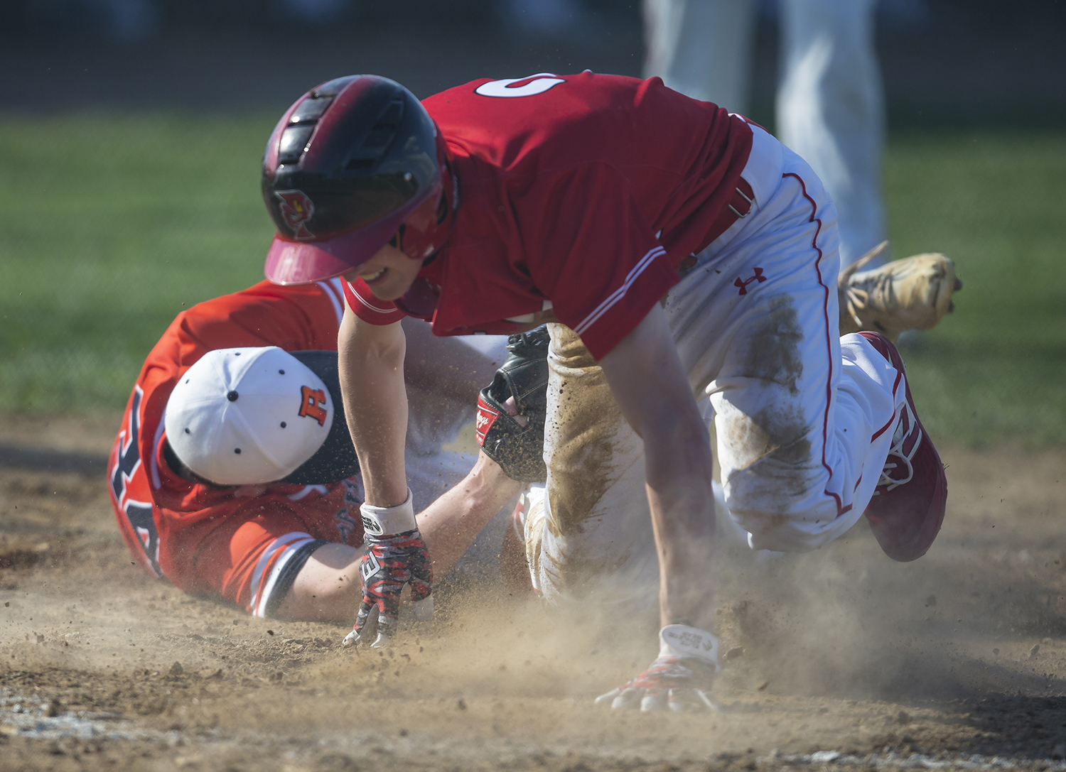 Glenwood's Nolan Rooney (2) beats the tag from Rochester's Cameron Edmonson (34) at home plate for a stolen base off a wild pitch scoring a run to put the Titans up 2-1 in the third inning at Rochester High School, Tuesday, April 16, 2019, in Rochester, Ill. [Justin L. Fowler/The State Journal-Register]