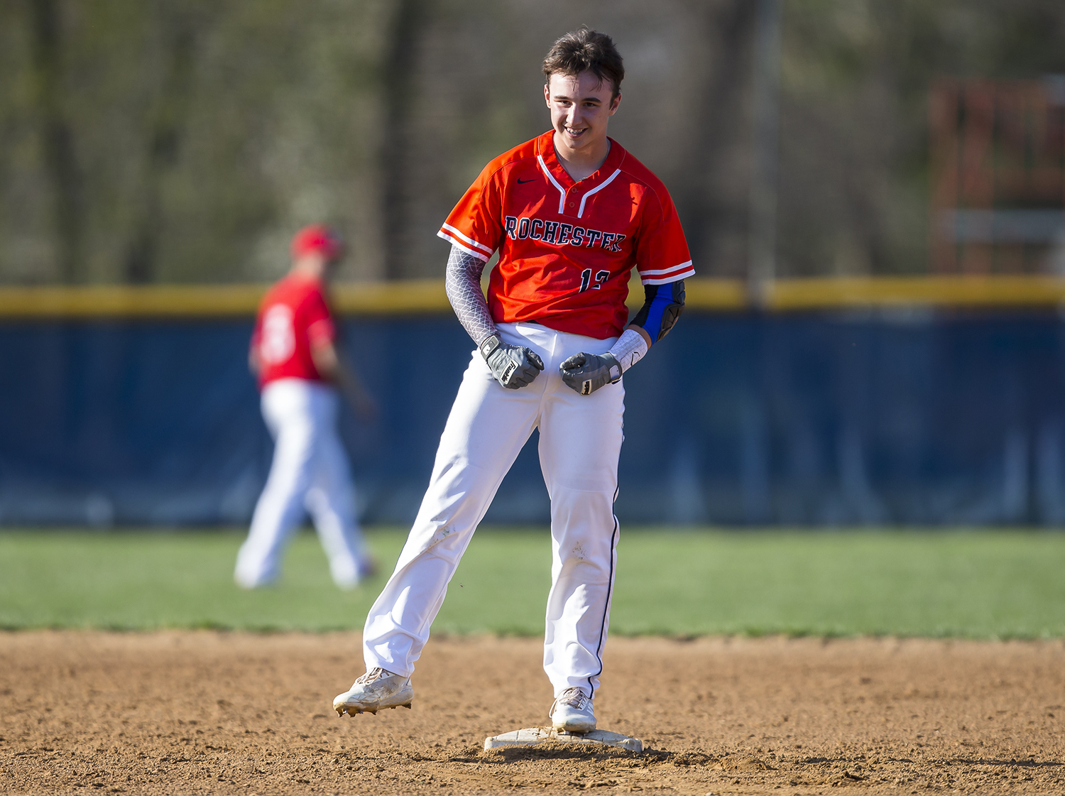 Rochester's Seth Parkinson (12) reacts after a double that scored two runs putting the Rockets up 5-3 over Glenwood in the fourth inning at Rochester High School, Tuesday, April 16, 2019, in Rochester, Ill. [Justin L. Fowler/The State Journal-Register]