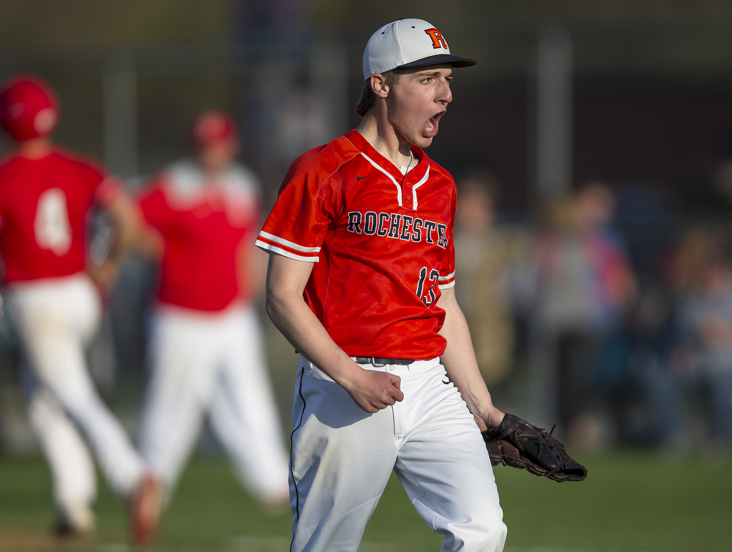 Rochester's Alex Bruno reacts after getting the save as the Rockets defeat Glenwood 5-4 at Rochester High School, Tuesday, April 16, 2019, in Rochester, Ill. [Justin L. Fowler/The State Journal-Register]