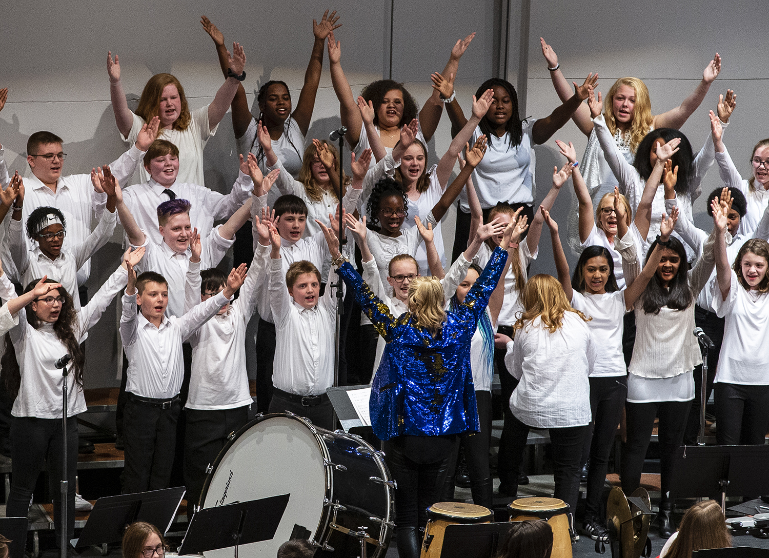 """The All City Middle School Choir, conducted by Jennifer Toney, hit the their mark in unison as they perform """"Come Alive"""" during the District 186 All City Music Festival at the Sangamon Auditorium on the campus of the Univeristy of Illinois Springfield, Wednesday, April 17, 2019, in Springfield, Ill. The performance, a tradition of over 30 years, is funded in part by the Springfield Public Schools Foundation and features around 450 students making up the All City Middle School Band and Choir along with the All City High School Band and Choir. [Justin L. Fowler/The State Journal-Register]"""