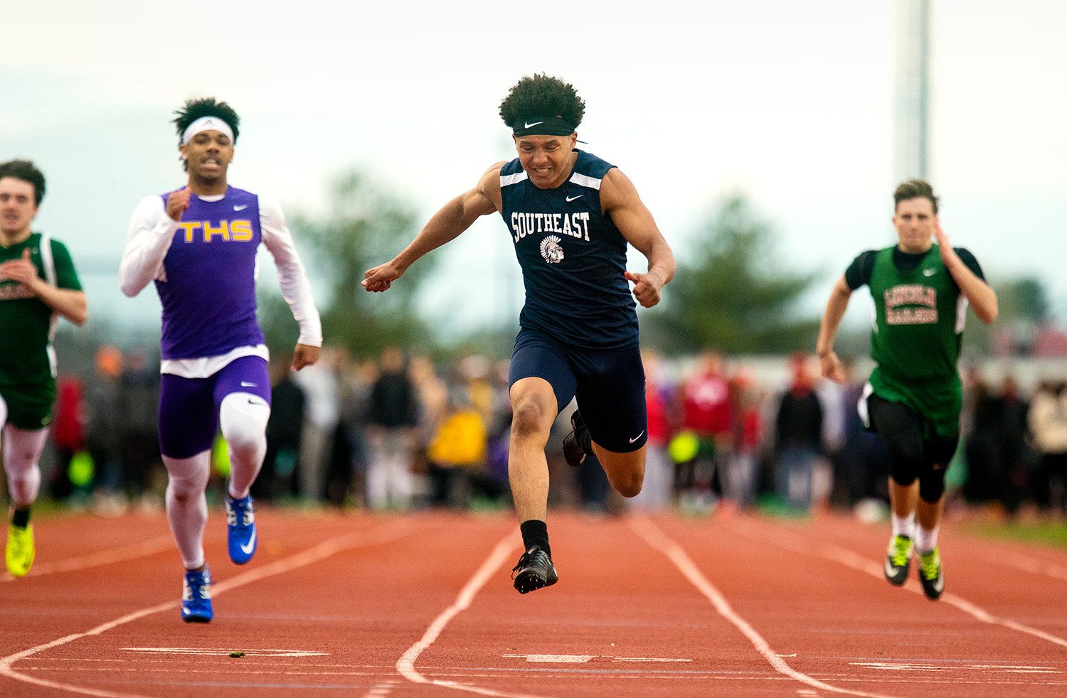Southeast's Deon Fairlee wins the 100 meter dash and sets a personal record during the 2019 Titan Co-Ed Invitational, 2019 at Glenwood High School Thursday, April 18, 2019. [Ted Schurter/The State Journal-Register]