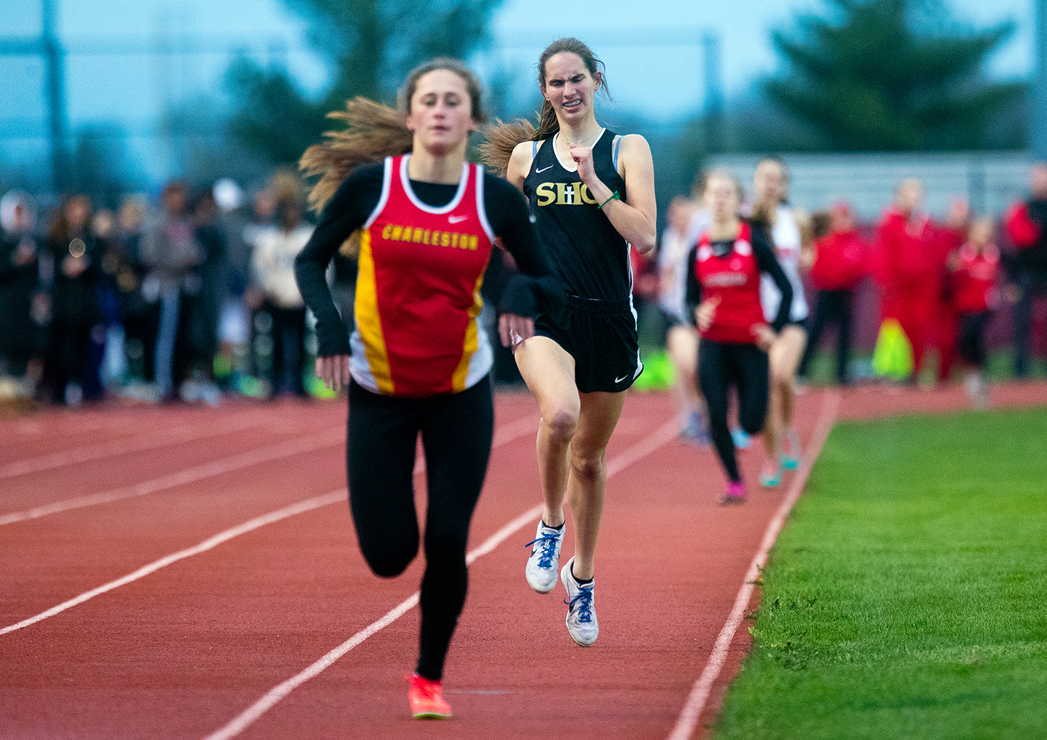Sacred Heart-Griffin's Mikayla Hady finishes behind Charleston's Megan Garrett in the 800 meter run during the 2019 Titan Co-Ed Invitational, 2019 at Glenwood High School Thursday, April 18, 2019. [Ted Schurter/The State Journal-Register]