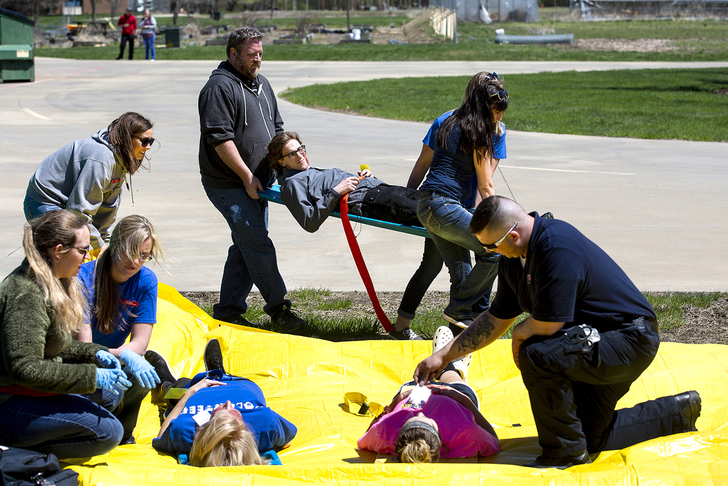 All hands were called to help with a simulated, mass-casualty disaster Saturday, April 20, 2019 at Lincoln Land Community College in Springfield, Ill. Approximately 70 students from the college's paramedic program, both basic and advanced, and nursing program worked together to triage volunteer victims who suffered burns, fractures and serious trauma. Nursing professor Pam Brown said the students learned the basics of Simple Triage Rapid Treatment, known as START, for first responders. [Rich Saal/The State Journal-Register]