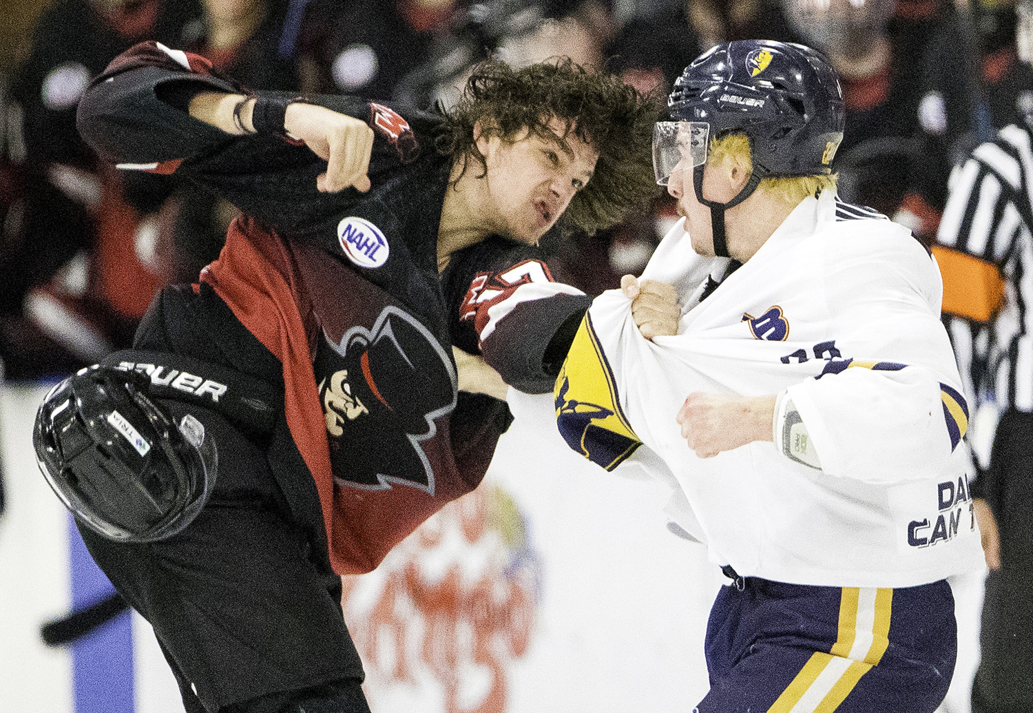 Minnesota's TJ Sagissor and Springfield's Brandon Puricelli exchange blows in the first period during the North American Hockey League playoff game at the Nelson Center Friday, April 19, 2019. [Ted Schurter/The State Journal-Register]