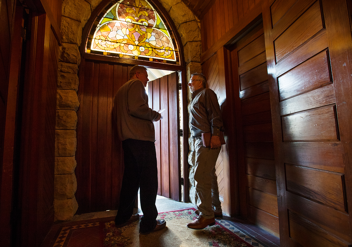 Lacy Hall, left, and Scott Payne visit while awaiting guests for the sunrise Easter service at St. John the Baptist Chapel Sunday, April 21, 2019. Payne preached for the morning service. [Ted Schurter/The State Journal-Register]