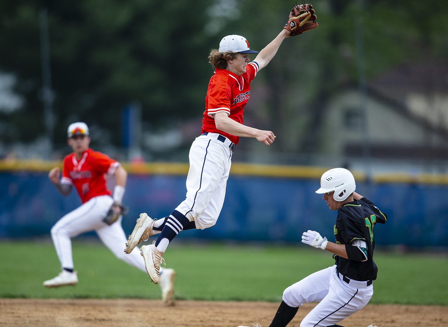 Rochester's Jayden Myren (3) leaps up trying to make a catch as Normal U-High's Jacob Moat (16) steals second base in the 3rd inning at Rochester High School, Tuesday, April 23, 2019, in Rochester, Ill. [Justin L. Fowler/The State Journal-Register]
