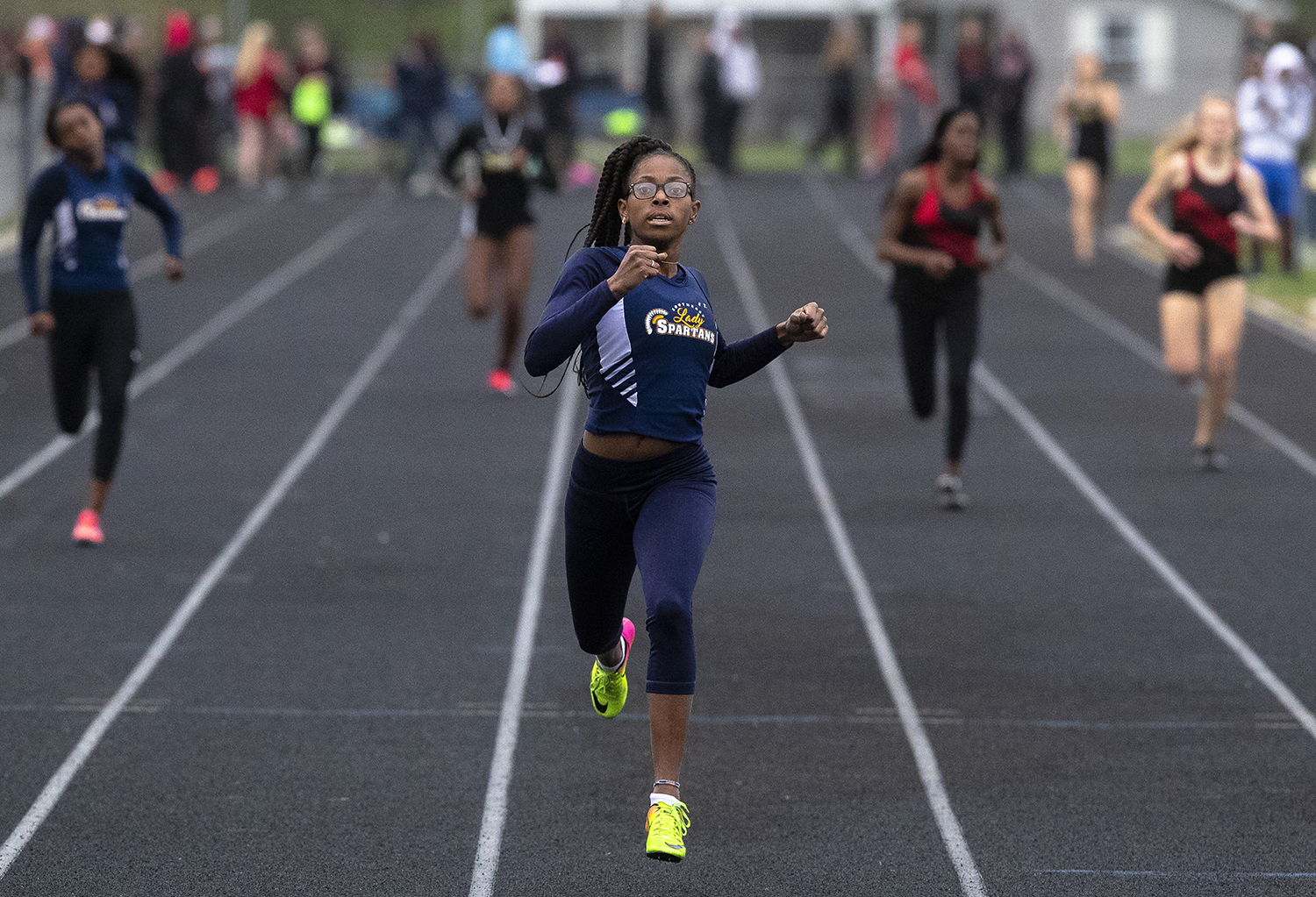 Southeast's Raven Moore is alone in first in the 400-meter dash with a time of 59.16 at the Girls City Track Meet Wednesday, April 24, 2019 at Southeast High School in Springfield, Ill. [Rich Saal/The State Journal-Register]
