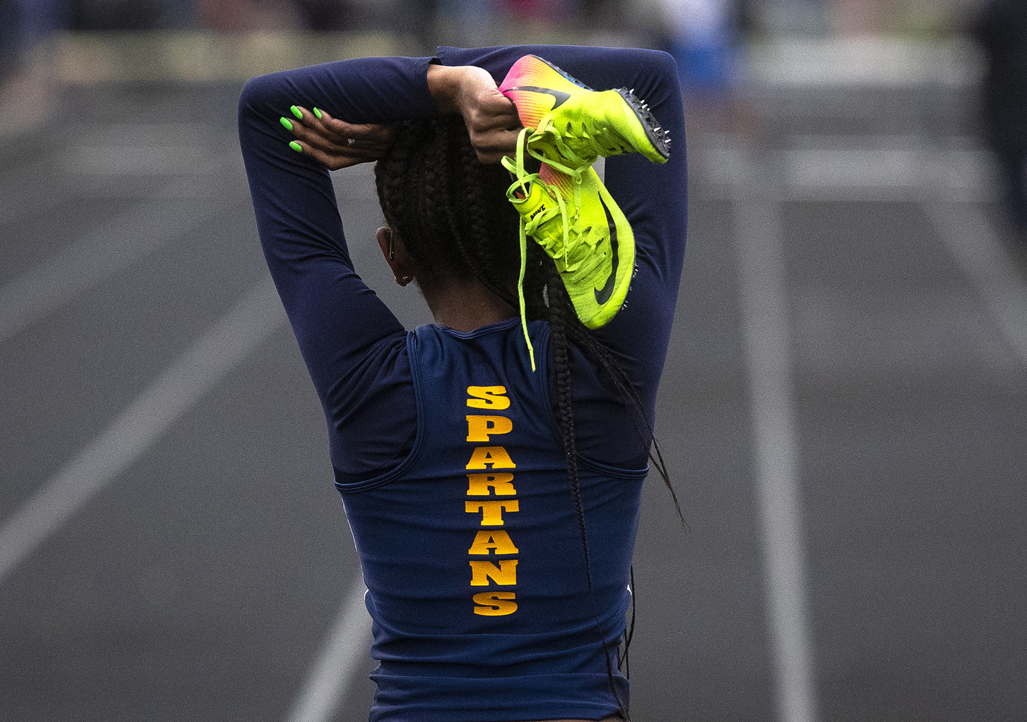 Southeast's Raven Moore recovers after the finish of the 400-meter dash at the Girls City Track Meet Wednesday, April 24, 2019 at Southeast High School in Springfield, Ill. [Rich Saal/The State Journal-Register]