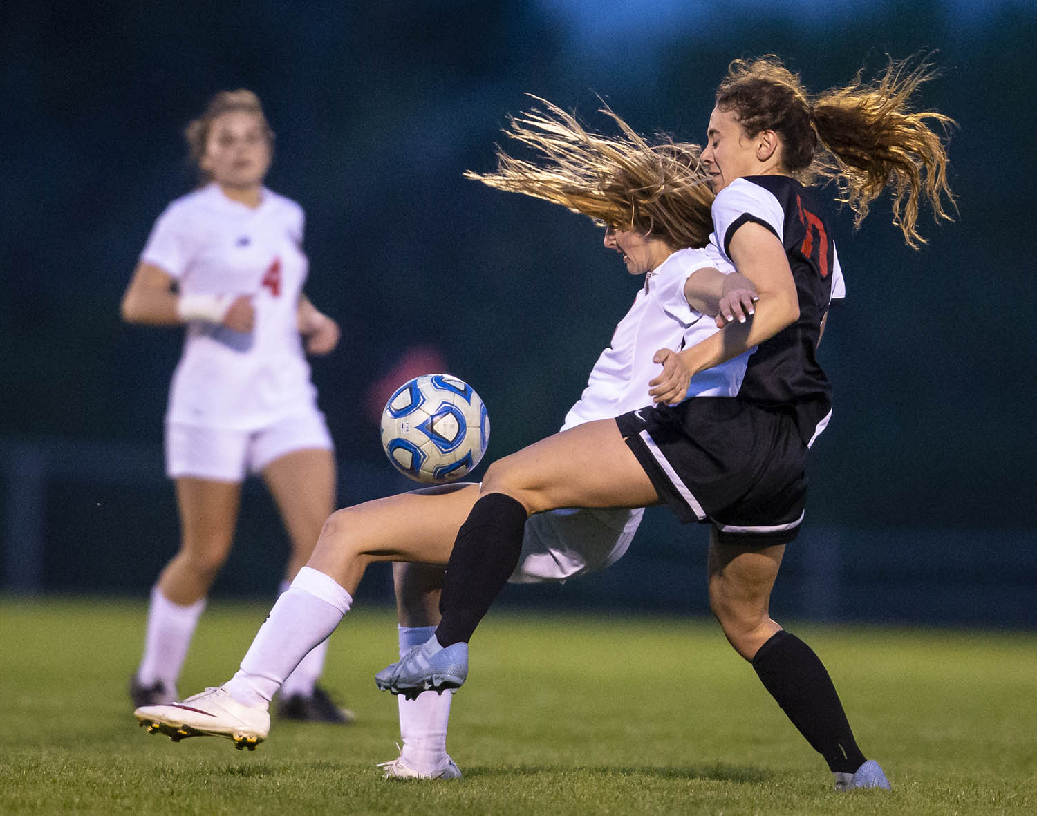 Glenwood's Darby Dixon (12) collides with Springfield's Emelie Lafrenz (10) as they go up for a ball out fo the air in the second half at Lee Field, Monday, April 29, 2019, in Springfield, Ill. [Justin L. Fowler/The State Journal-Register]
