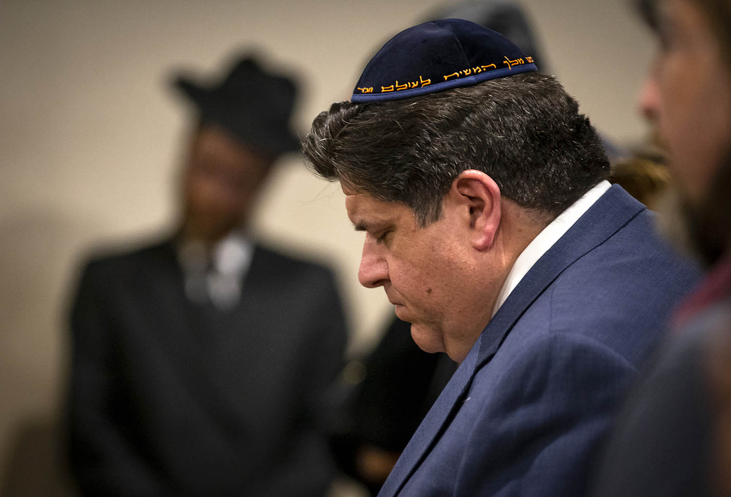 """Illinois Governor J.B. Pritzker bows his head during a song of prayer during the """"Unity, Solidarity & Prayer"""" program in response to the attack at the Chabad of Poway in California at the President Abraham Lincoln Hotel, Tuesday, April 30, 2019, in Springfield, Ill. [Justin L. Fowler/The State Journal-Register]"""