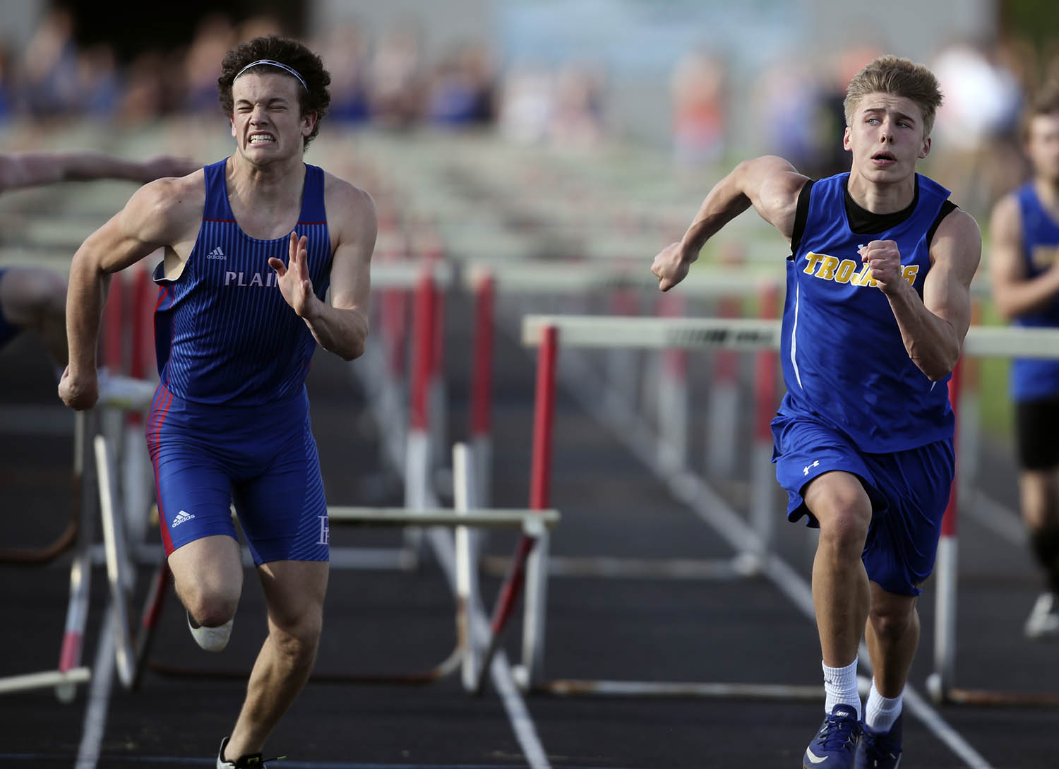 Maroa-Forsyth's Noah Holthaus peaks over at Pleasant Plains' Keigan Halford as he edges him out at the line to win the Boys 110m Hurdles with a time of 15.68 to Halford's 15.75 during the Sangamo Conference Track Meet at Pleasant Plains High School, Wednesday, May 1, 2019, in Pleasant Plains, Ill. [Justin L. Fowler/The State Journal-Register]