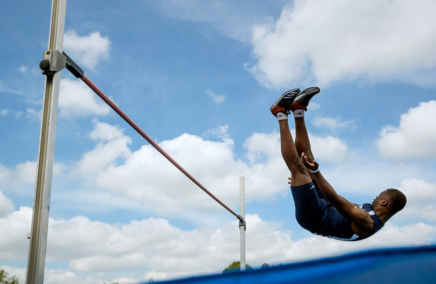 Southeast's David Emuze glides down for a landing in the high jump at the 2019 Springfield Boys City Meet at Memorial Stadium Saturday, May 4, 2019. Emuze won the event with a jump of 6-05 feet. [Ted Schurter/The State Journal-Register]