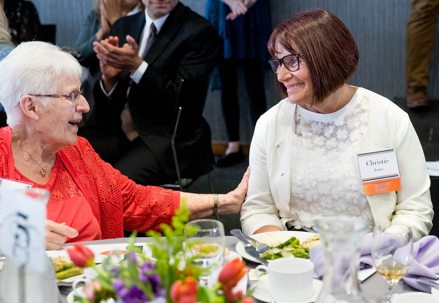 Frances Ryan, left, smiles at her niece Christie Jones, an eighth grade writing, literature, and AVID teacher at Lincoln Magnet School, after she was named the 2019 Horace Mann Educator of the Year during a ceremony Tuesday, May 7, 2019. Jones credits Ryan as being the inspiration for her teaching career. [Ted Schurter/The State Journal-Register]
