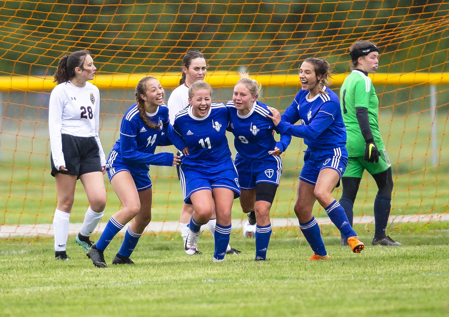 Lutheran's Allison Blade (11) celebrates with her teammates after scoring a goal to tie the game 1-1 against Williamsville in the second half during the Class 1A Riverton Regional Championship at the Riverton Field of Dreams, Saturday, May 11, 2019, in Riverton, Ill. [Justin L. Fowler/The State Journal-Register]