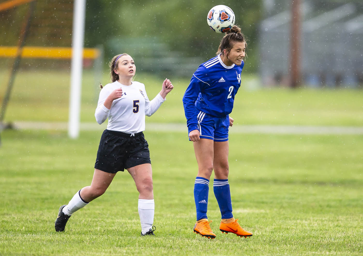 Lutheran's Emily Stoeckel (2) wins a header over Williamsville's Aubreyanna Brown (5) in the second half during the Class 1A Riverton Regional Championship at the Riverton Field of Dreams, Saturday, May 11, 2019, in Riverton, Ill. [Justin L. Fowler/The State Journal-Register]