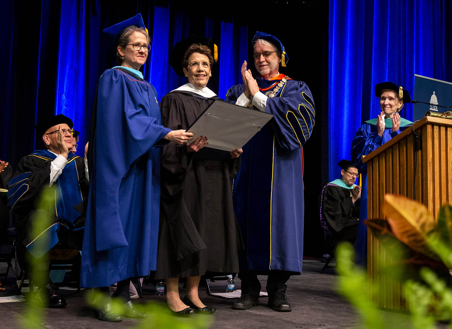 Karen Hasara, center, former Mayor of Springfield, is awarded an honorary degree of Doctor of Human Letters by DeeDee Williams, left, secretary of the University of Illinois Board of Trustees and University of Illinois President Timothy L. Killeen and University of Illinois Springfield Chancellor Susan Koch, right, during the University of Illinois Springfield's 48th annual Commencement Ceremonies at the Back of Springfield Center, Saturday, May 11, 2019, in Springfield, Ill. [Justin L. Fowler/The State Journal-Register]
