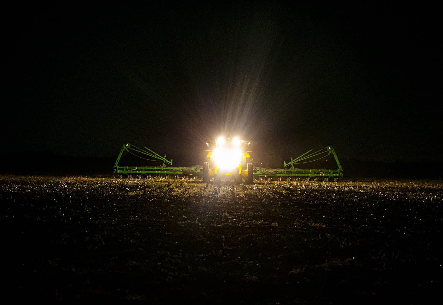 "Lee Curby pilots a planter with Steve Copp late into the night as they push to get as much done as the weather allows in a field along Alpha Road, Friday, May 17, 2019, in south of Chatham, Ill. ""We're not out of the woods, but every day that we get is a bit better,"" said Curby of the break in wet weather that has allowed him to get in the fields to work on getting his crop planted. The exceptionally wet spring has led to only 11% of Illinois' corn crop to be planted as of May 12th compared to 88% at the same time in 2018. [Justin L. Fowler/The State Journal-Register]"