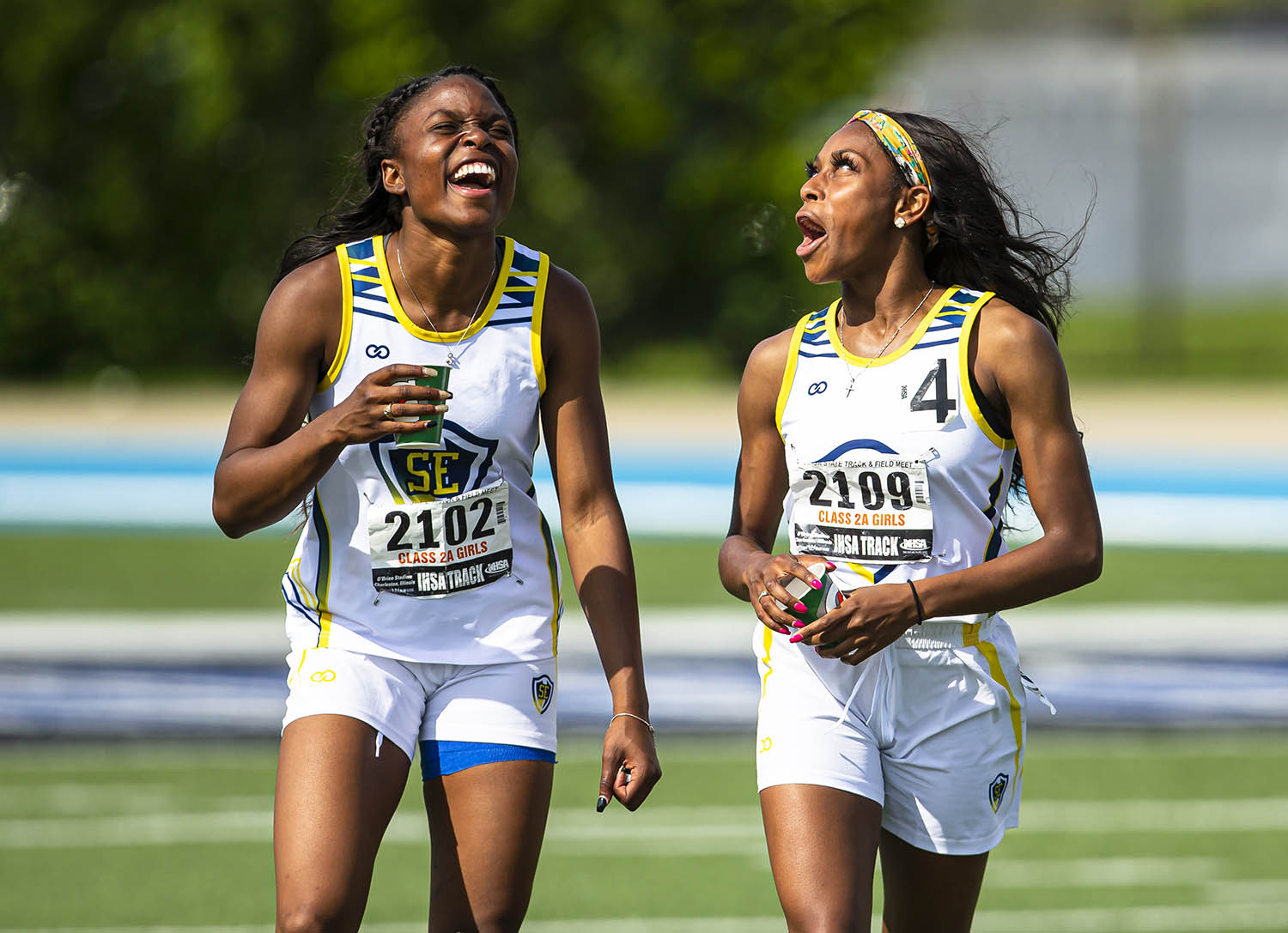 Southeast's Serena Bolden and Raven Moore joke around after finishing 1st and 3rd respectively in the Class 2A 200m Dash during the IHSA Girls Track & Field State Finals at O'Brien Field on the campus of Eastern Illinois University , Saturday, May 18, 2019, in Charleston, Ill. [Justin L. Fowler/The State Journal-Register]