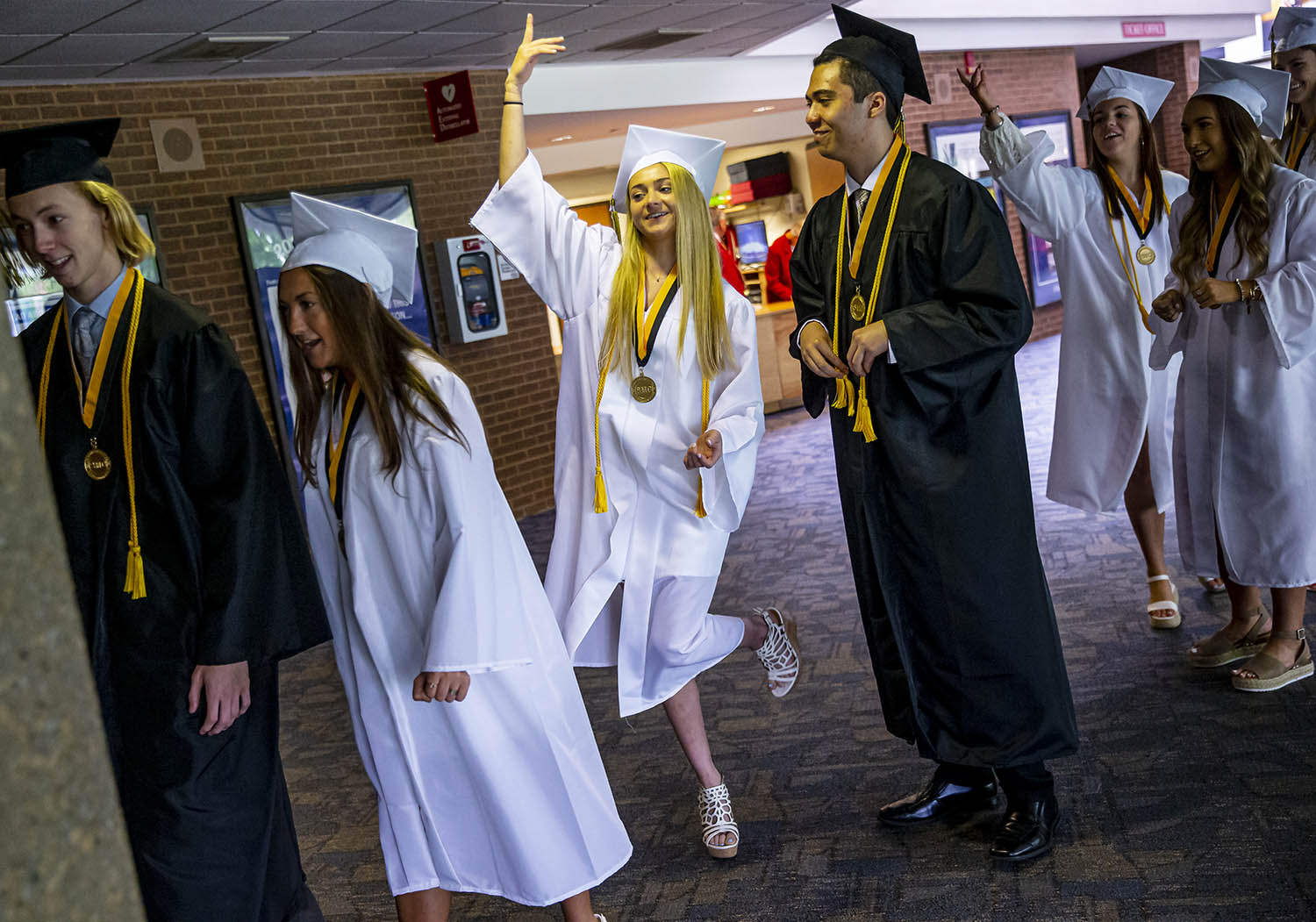 Peyton Vorreyer, a member of the National Honor Society and an Illinois State Scholar, rehearses a move with her classmates as they talk about they are going to march in during the Sacred Heart-Griffin 2019 Graduation Ceremony at the Sangamon Auditorium on the campus of the University of Illinois Springfield, Sunday, May 19, 2019, in Springfield, Ill. [Justin L. Fowler/The State Journal-Register]