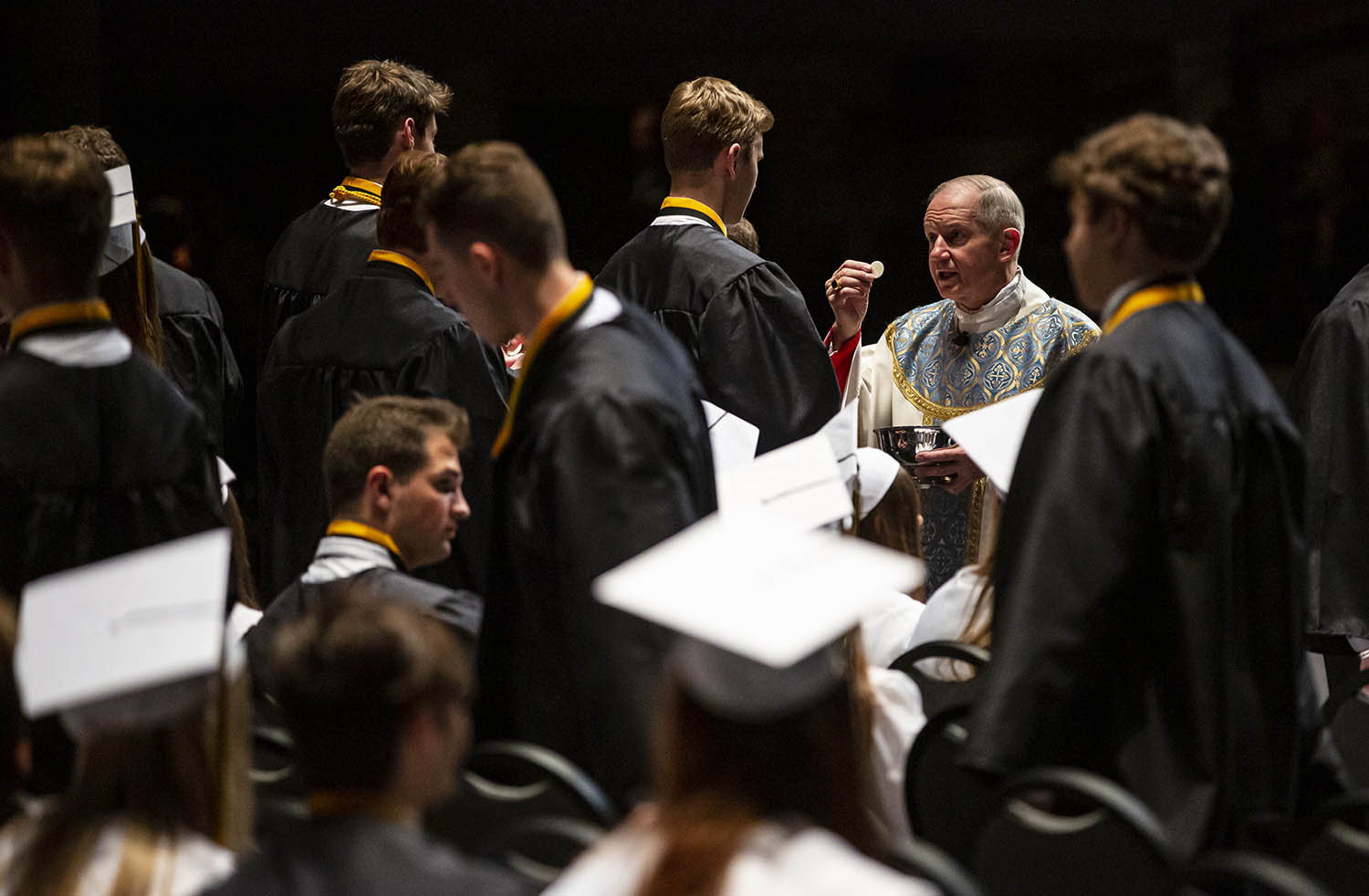 Bishop Thomas John Paprocki delivers communion as part of the graduation mass during the Sacred Heart-Griffin 2019 Graduation Ceremony at the Sangamon Auditorium on the campus of the University of Illinois Springfield, Sunday, May 19, 2019, in Springfield, Ill. [Justin L. Fowler/The State Journal-Register]