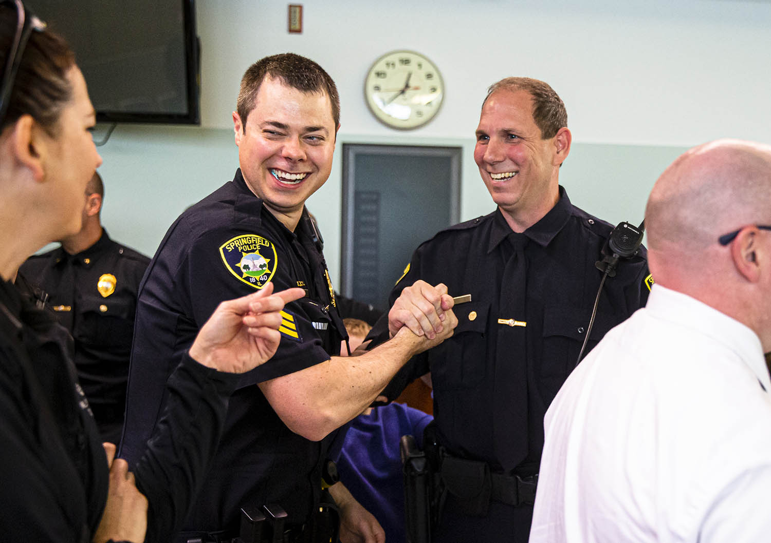 Springfield Police Sergeant Andy Zander, right, is congratulated after his promotion to sergeant during a swearing-in and promotion ceremony for Springfield Police Officers in the City Council Chambers, Monday, May 20, 2019, in Springfield, Ill. [Justin L. Fowler/The State Journal-Register]