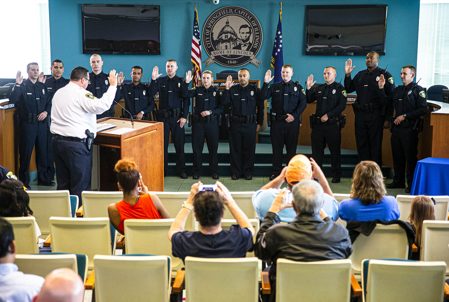 Eleven new officers are sworn in by Springfield Police Chief Kenny Winslow during a swearing-in and promotion ceremony for Springfield Police Officers in the City Council Chambers, Monday, May 20, 2019, in Springfield, Ill. [Justin L. Fowler/The State Journal-Register]