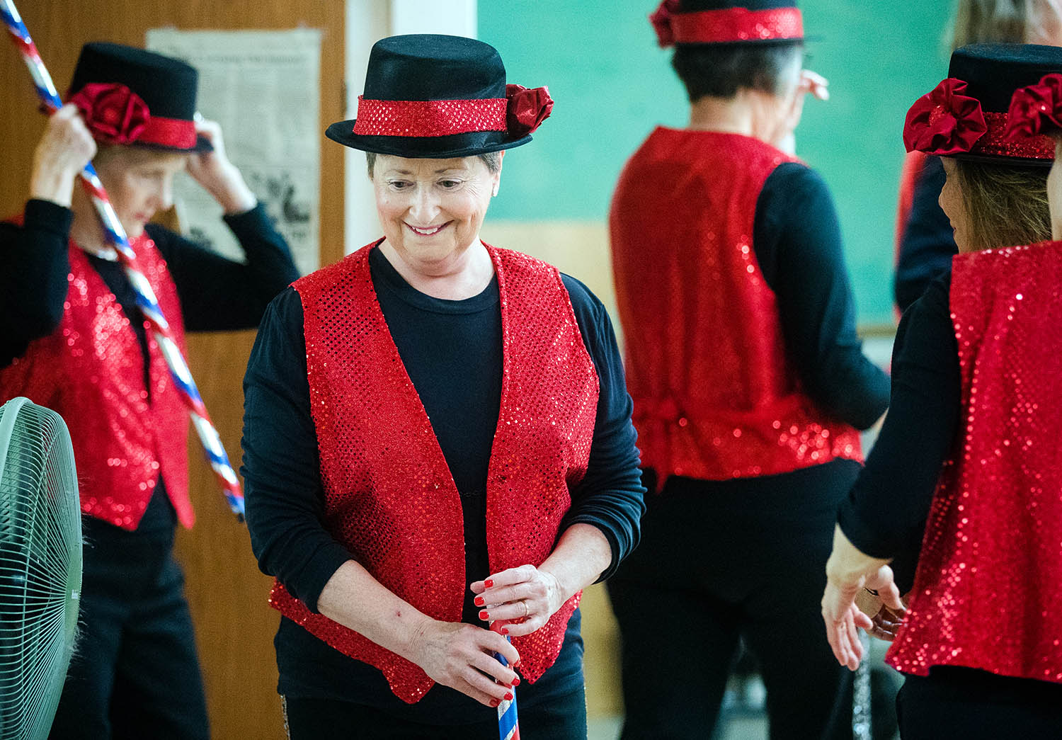 Arlene Cooney and other members of the Tip Top Tappers prepare to perform their Memorial Day tribute at the Senior Center Friday, May 24, 2019. The group performs regularly and practices twice a week at the center. New members are welcome to join them at 10 a.m. for their Thursday practice. [Ted Schurter/The State Journal-Register]