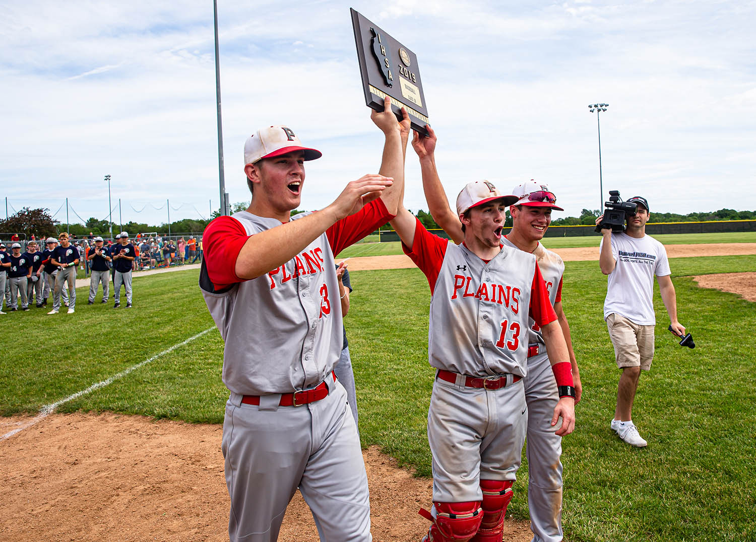 Pleasant Plains' Cam Furbeck (23), Corgan Greer (13) and Joe Lee (14) celebrate with the championship plaque after defeating New Berlin 11-4 in the Class 2A Pleasant Plains Sectional championship game at Reiser Field, Saturday, May 25, 2019, in Pleasant Plains, Ill. [Justin L. Fowler/The State Journal-Register]