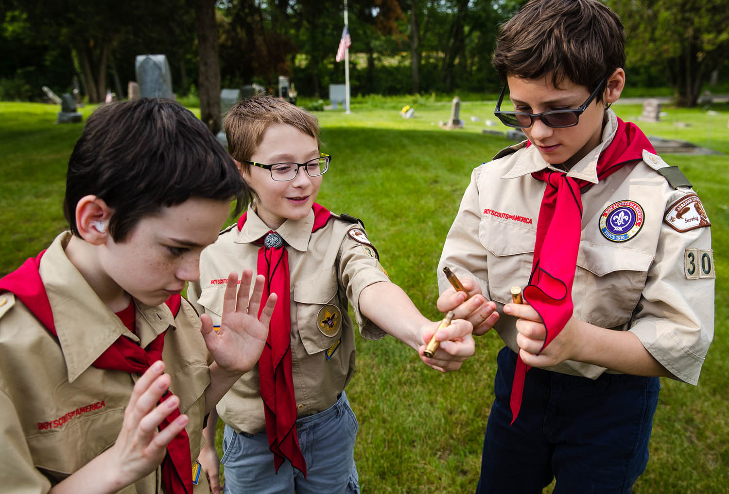 Members of Boy Scout Troop 305 compare the spent shell casings they collected at the conclusion of a Memorial Day observance at Salisbury Cemetery Monday, May 27, 2019. [Ted Schurter/The State Journal-Register]