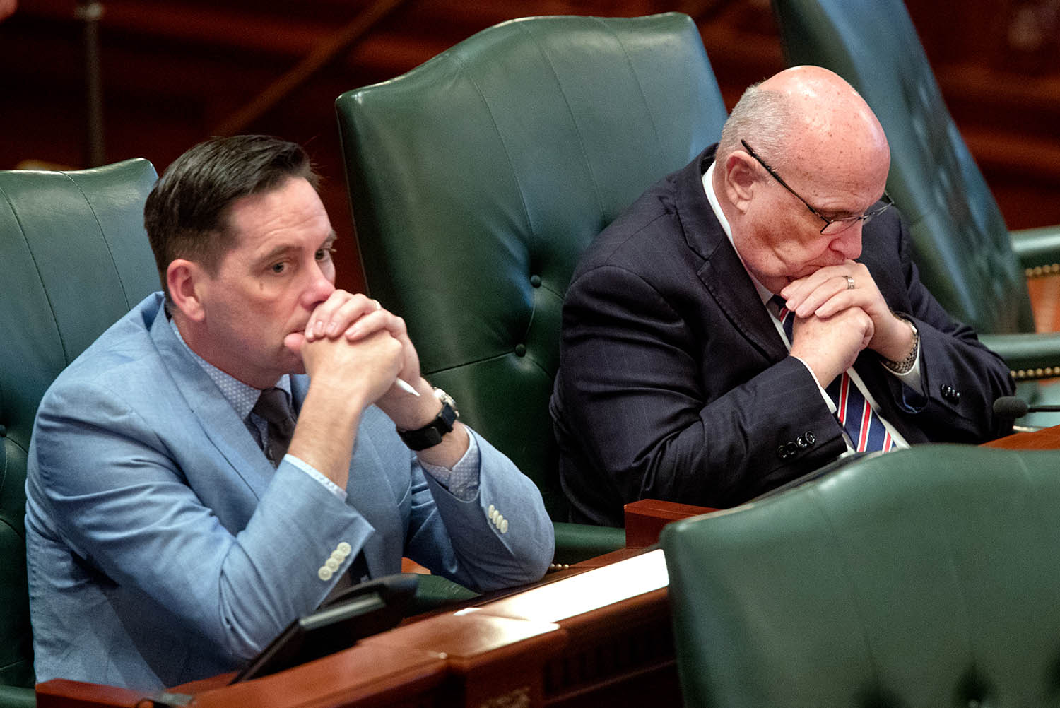 Illinois state Rep. Mike Murphy, R-Springfield, bows his head as he listens to debate on the Reproductive Health Act on the floor of the Illinois House chambers Tuesday, May 28, 2019. State Rep. Tim Butler, R-Springfield, is at left. [Ted Schurter/The State Journal-Register]