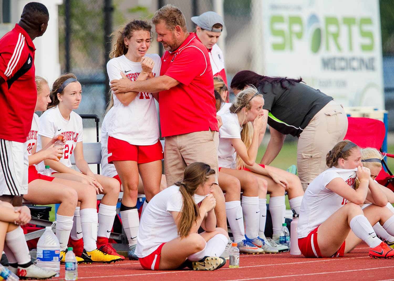 Springfield head coach Patrick Phillips consoles Springfield's Emelie Lafrenz as time runs out during the 2A Glenwood Supersectional at Glenwood High School Tuesday, May 28, 2019. Troy Triad defeated Springfield 2-0. [Ted Schurter/The State Journal-Register]