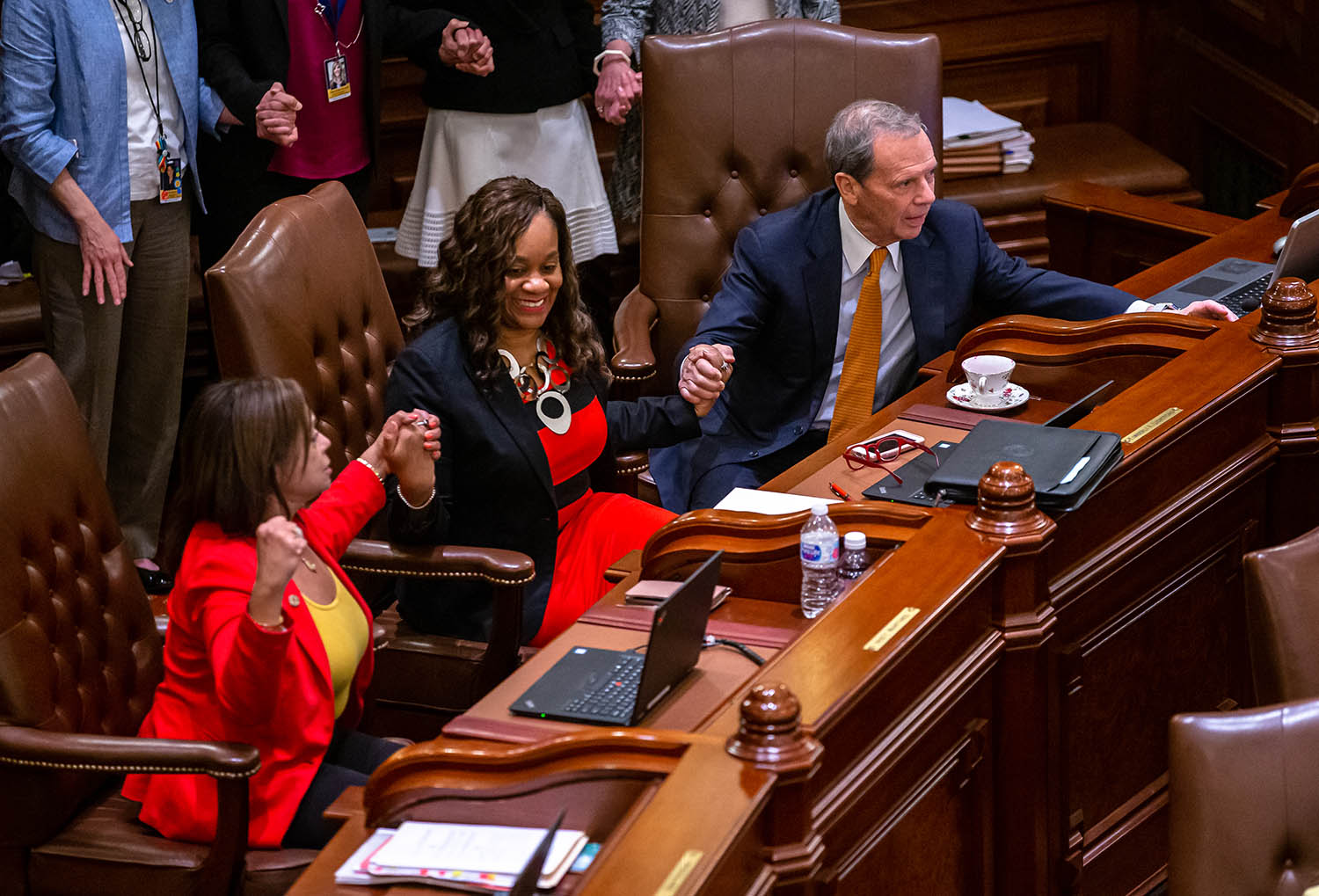 Illinois Senate President John Cullerton, D-Chicago, joins hands with Illinois State Sen. Kimberly A. Lightford, D-Maywood, center, and Illinois State Sen. Iris Martinez, D-Chicago, left, as they vote on the Reproductive Health Act on the floor of the Illinois Senate late into the evening on the scheduled last day of the Spring Session at the Illinois State Capitol, Friday, May 31, 2019, in Springfield, Ill. [Justin L. Fowler/The State Journal-Register]