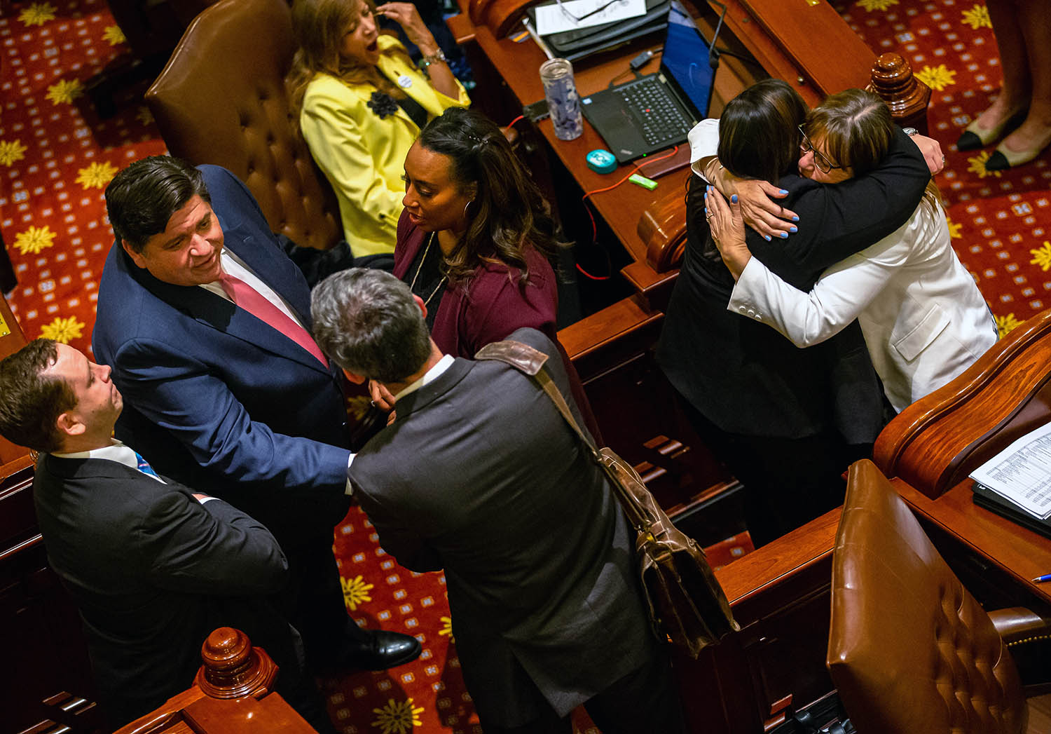Illinois Governor J.B. Pritzker, left, and Illinois State Sen. Melinda Bush, D-Grayslake, right, celebrate passing the Reproductive Health Act, an abortion rights bill establishing a fundamental right for women to get an abortion, in the Illinois Senate in a 34-20 vote late into the evening on the scheduled last day of the Spring Session at the Illinois State Capitol, Friday, May 31, 2019, in Springfield, Ill. [Justin L. Fowler/The State Journal-Register]