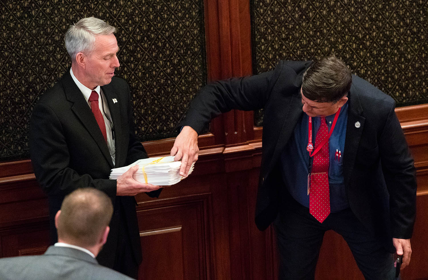 Illinois state Rep. Patrick Windhorst, R-Metropolis, poses with a print out of the 1581 pages of the just released Illinois state budget on the floor of the Illinois House chambers Friday, May 31, 2019. [Ted Schurter/The State Journal-Register]