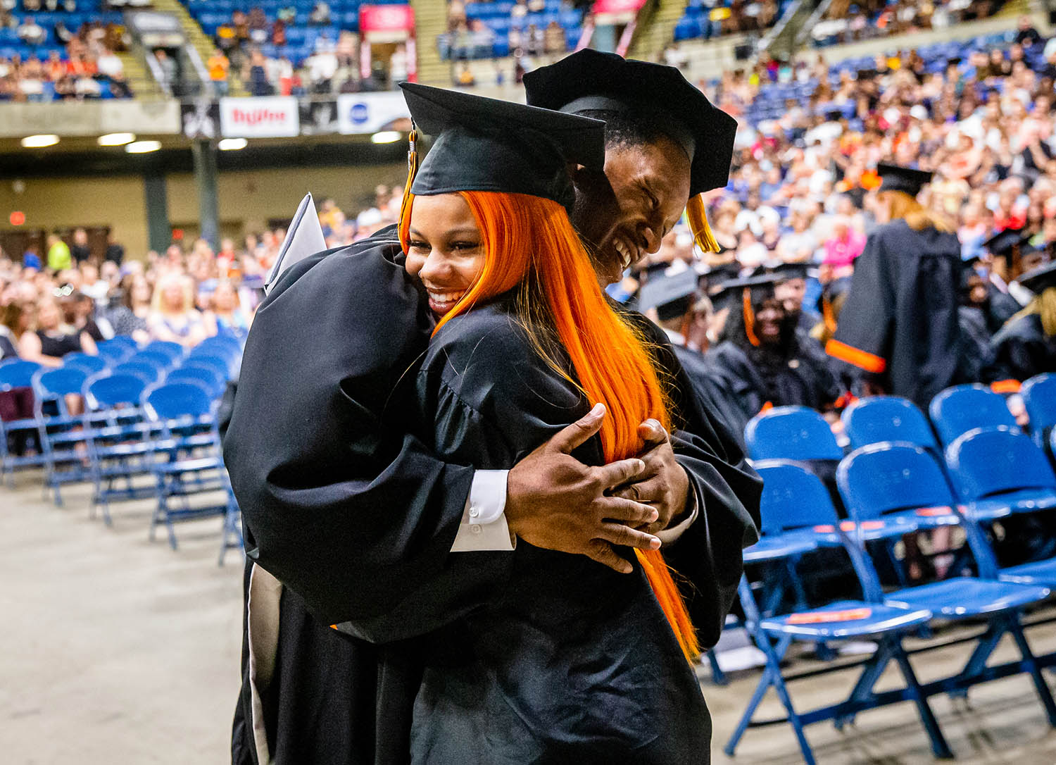 Lanphier Principal Artie Doss congratulates senior class treasurer Gabbi Sturdivant after she received her diploma during Lanphier High School's 82nd Commencement at the Bank of Springfield Center, Saturday, June 1, 2019, in Springfield, Ill. District 186 had 764 students between Lanphier, Springfield, and Southeast receive their diplomas on Saturday with the combined class being offered $43.7 million in scholarships. [Justin L. Fowler/The State Journal-Register]