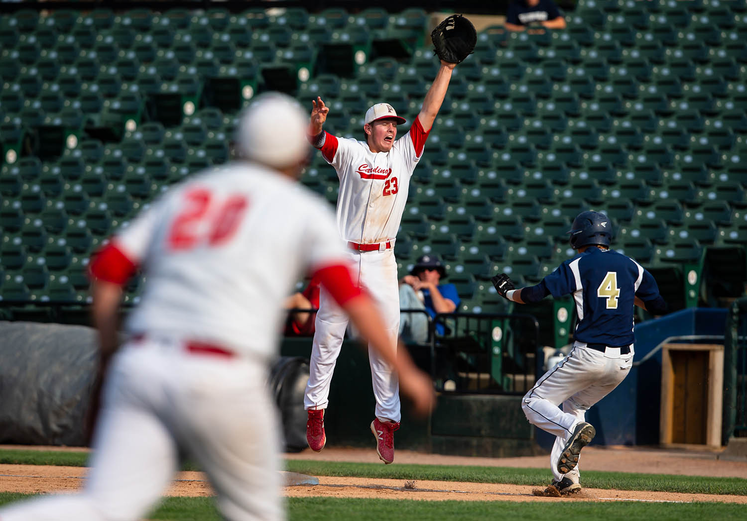 Pleasant Plains' Cam Furbeck (23) is unable to leap up to catch the throw form Pleasant Plains' Drew Washam (20) on a hit from Teutopolis' Justin Hardiek (4) in the second inning during the IHSA Class 2A State Championship game at Dozer Park, Saturday, June 1, 2019, in Peoria, Ill. [Justin L. Fowler/The State Journal-Register]