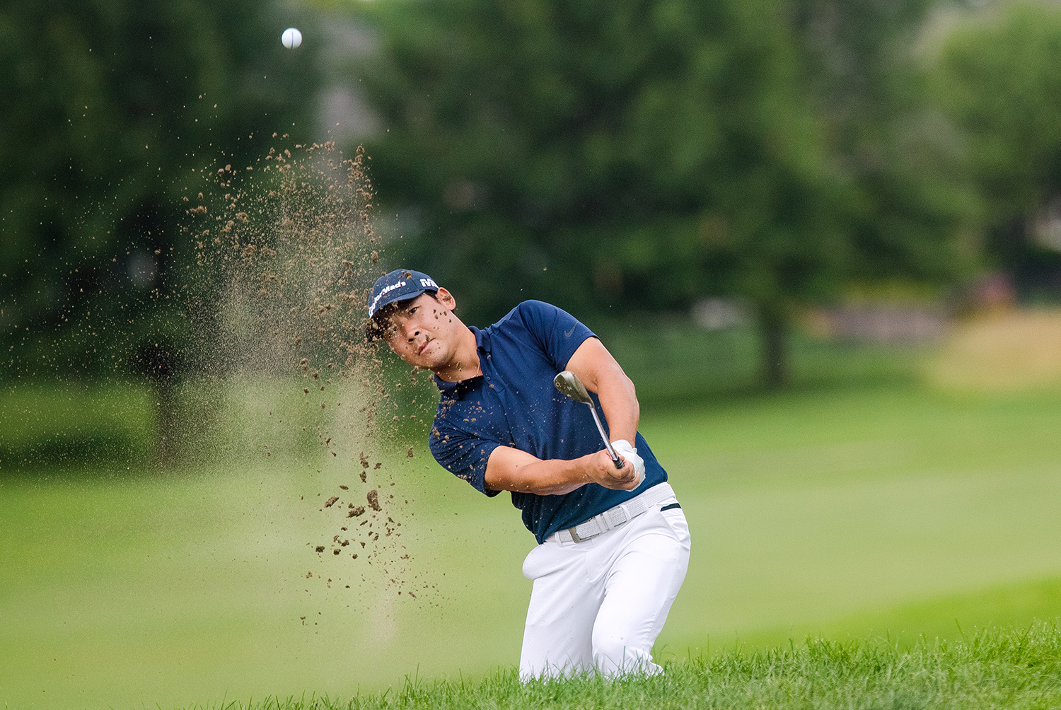 Xinjun Zhang hits out of a bunker on the 16th hole during the fourth round of Web.com Tour's Lincoln Land Championship presented by LRS Sunday, June 16, 2019. Zhang picked up his second consecutive birdie on the hole, putting him at 15 under and forcing a playoff that he won with Dylan Wu. [Ted Schurter/The State Journal-Register]