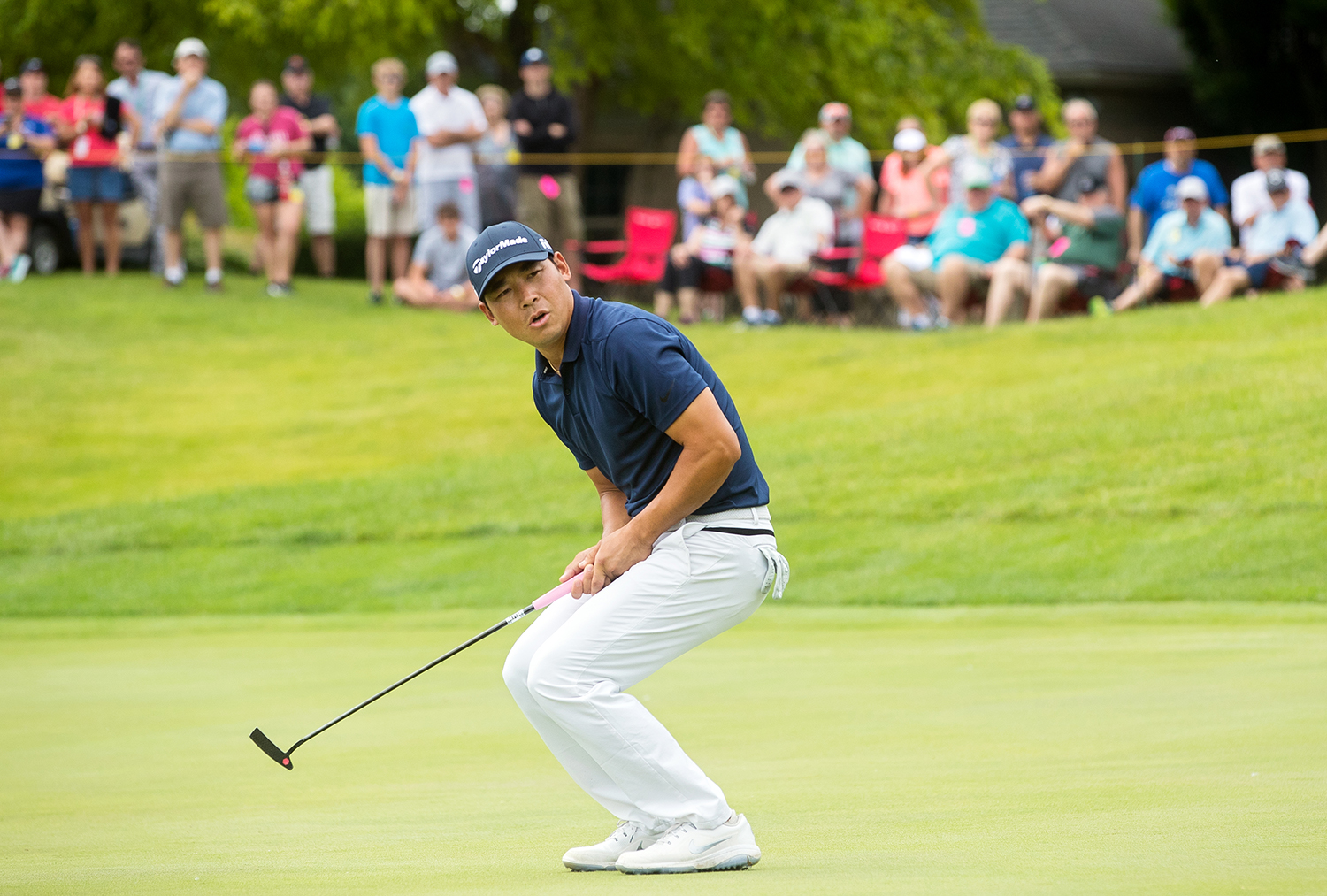 Xinjun Zhang reacts as the potentially championship-winning birdie putt just misses on the 18th green during the fourth round of Web.com Tour's Lincoln Land Championship presented by LRS Sunday, June 16, 2019. Zhang went on to win a three-hole playoff against Dylan Wu. [Ted Schurter/The State Journal-Register]