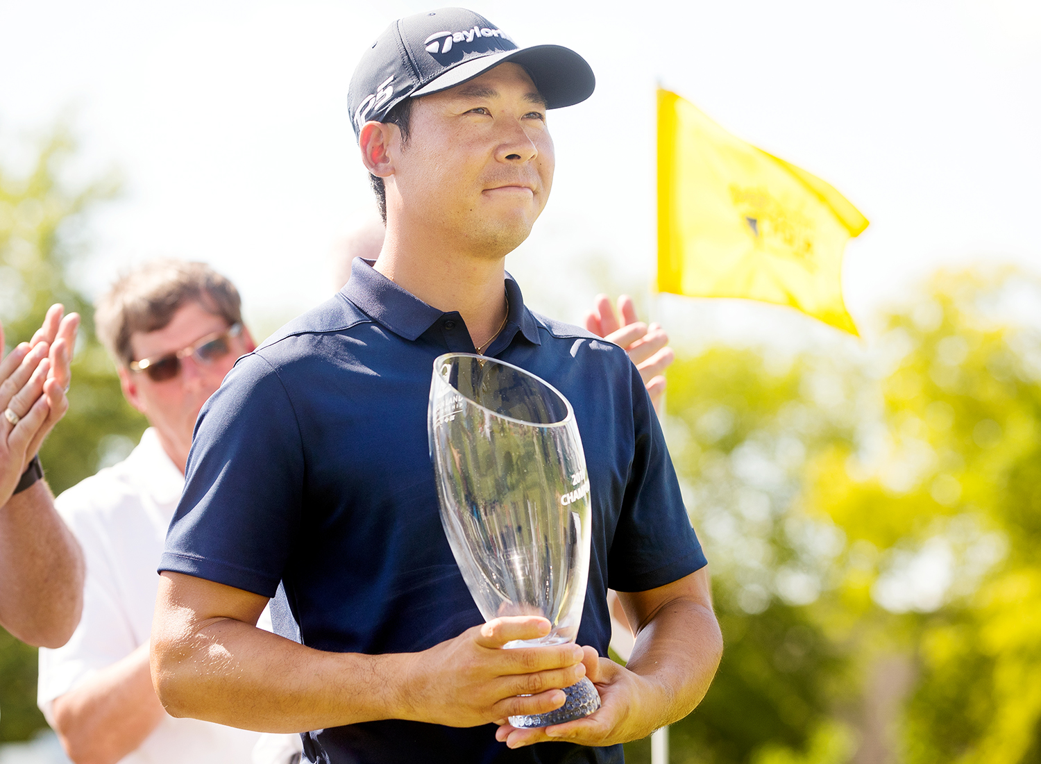 The 2019 Web.com Tour's Land of Lincoln Championship winner, Xinjun Zhang, poses with his trophy on the 18th green at Panther Creek Country Club golf course Sunday, June 16, 2019. Zhang survived a three-hole playoff against Dylan Wu to earn his second tour win this year. [Ted Schurter/The State Journal-Register]
