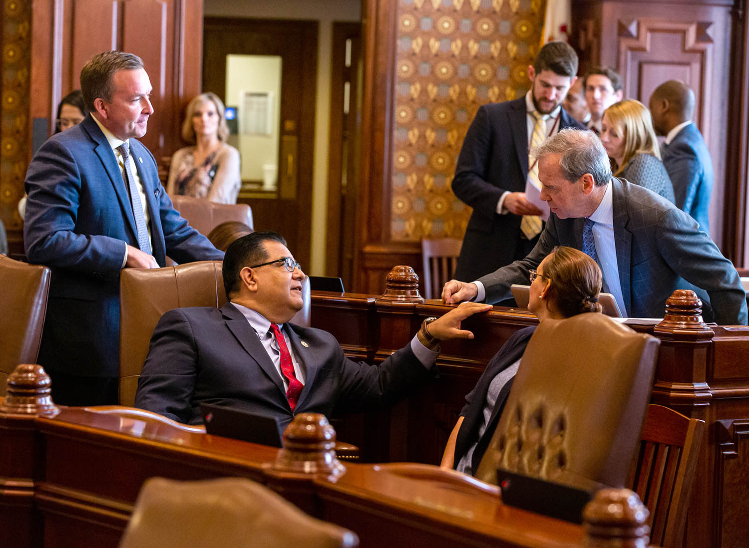Illinois Senate President John Cullerton, D-Chicago, talks with Illinois State Sen. Andy Manar, D-Bunker Hill, and Illinois State Sen. Martin Sandoval, D-Chicago, after passing of the capital construction plan on the floor of the Illinois Senate during overtime of the Spring Session at the Illinois State Capitol, Sunday, June 2, 2019, in Springfield, Ill. [Justin L. Fowler/The State Journal-Register]