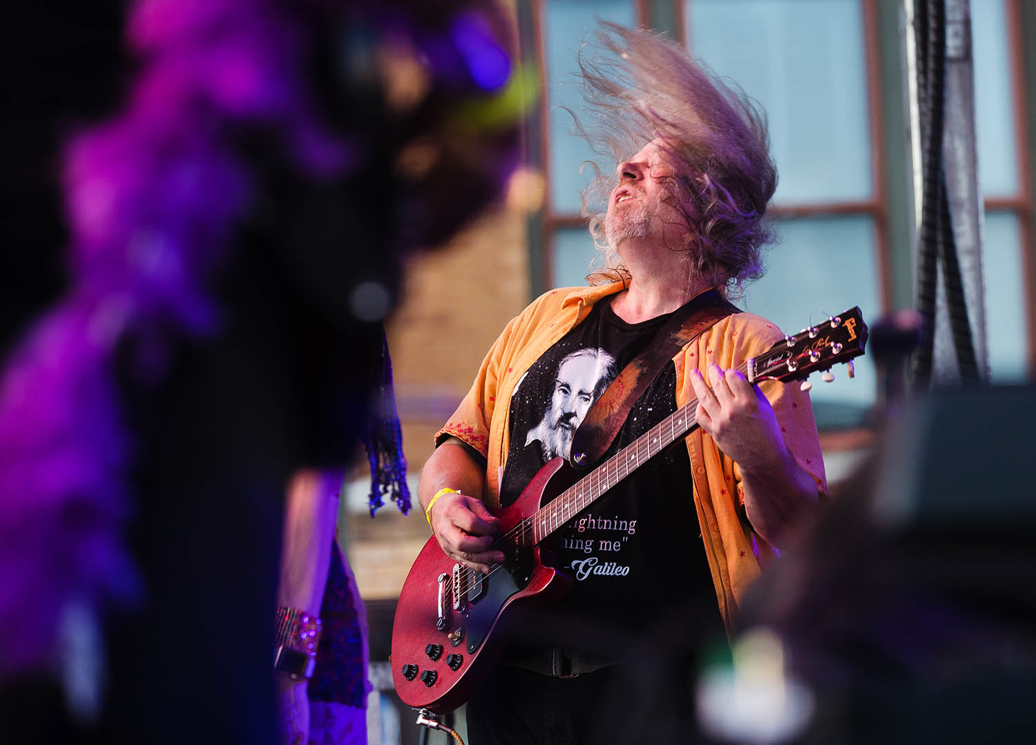 Carl Akers jams with Purple Stardust during the Legacy of Giving Music Festival in downtown Springfield Friday, June 7, 2019. [Ted Schurter/The State Journal-Register]