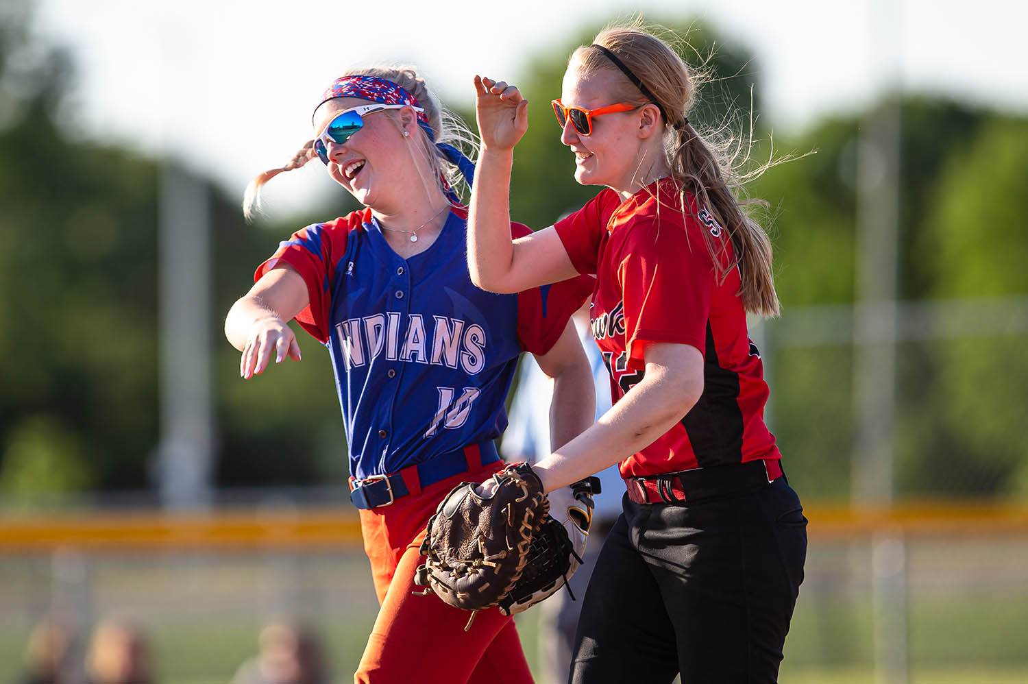 Pawnee's Carsen Jarrett and Morrisonville's Hallie Schneider high five after as they come off the field after finishing out the sixth inning against the CS8 All-Stars during the 2019 Land of Lincoln Softball Classic at the Land of Lincoln Jr. Olympic Softball Complex, Monday, June 10, 2019, in Springfield, Ill. [Justin L. Fowler/The State Journal-Register]