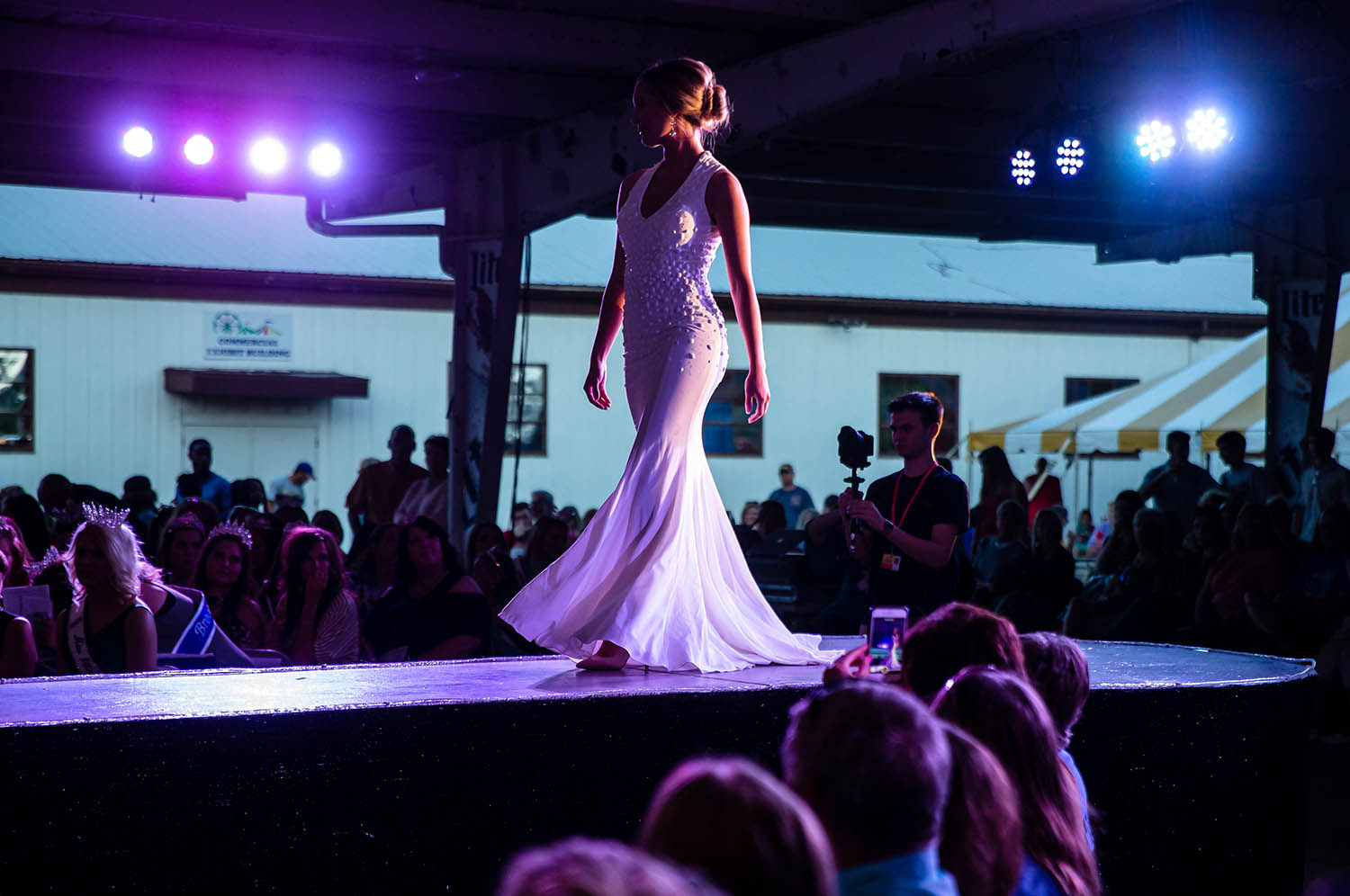 Lauryn Leonard makes the turn as she walks the runway during the Evening Gown Competition during the 61st annual Sangamon County Fair Queen Pageant at the Sangamon County Fairgrounds, Tuesday, June 11, 2019, in New Berlin, Ill. [Justin L. Fowler/The State Journal-Register]