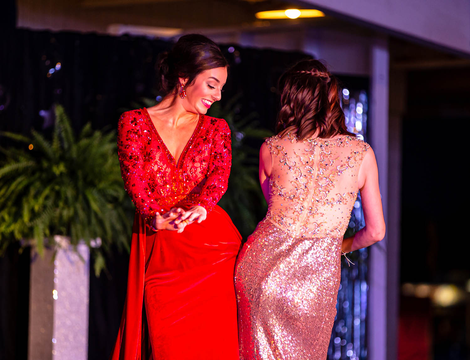Savannah Norris and Elizabeth Moose bump hips as they make the final walk in the Grand March during the 61st annual Sangamon County Fair Queen Pageant at the Sangamon County Fairgrounds, Tuesday, June 11, 2019, in New Berlin, Ill. [Justin L. Fowler/The State Journal-Register]