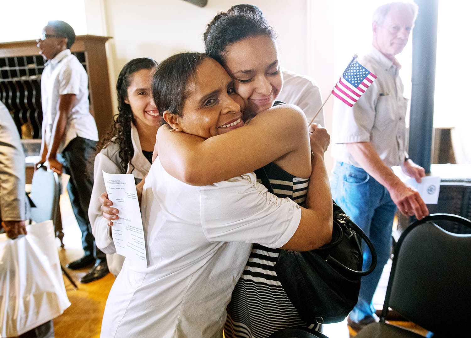 Divina Rosa Kluge is embraced by her daughter Divina after she received her citizenship during a naturalization ceremony at the Old State Capitol Friday, June 14, 2019. [Ted Schurter/The State Journal-Register]