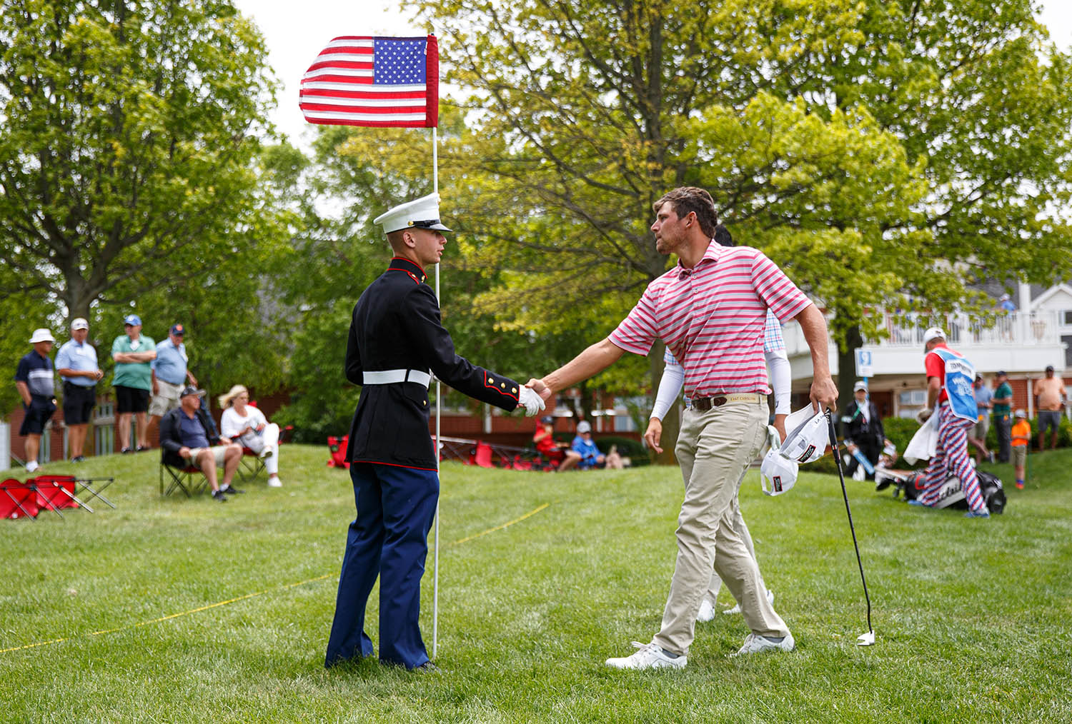 Marine Pvt. Jaden Maglioacchetti, of Quincy, Ill., shakes hands with Web.com Tour player Zachary Edmondson while holding the pin with an American Flag during Military Day on the second round of the Lincoln Land Championship presented by LRS at Panther Creek Country Club, Friday, June 14, 2019, in Springfield, Ill.  [Justin L. Fowler/The State Journal-Register]