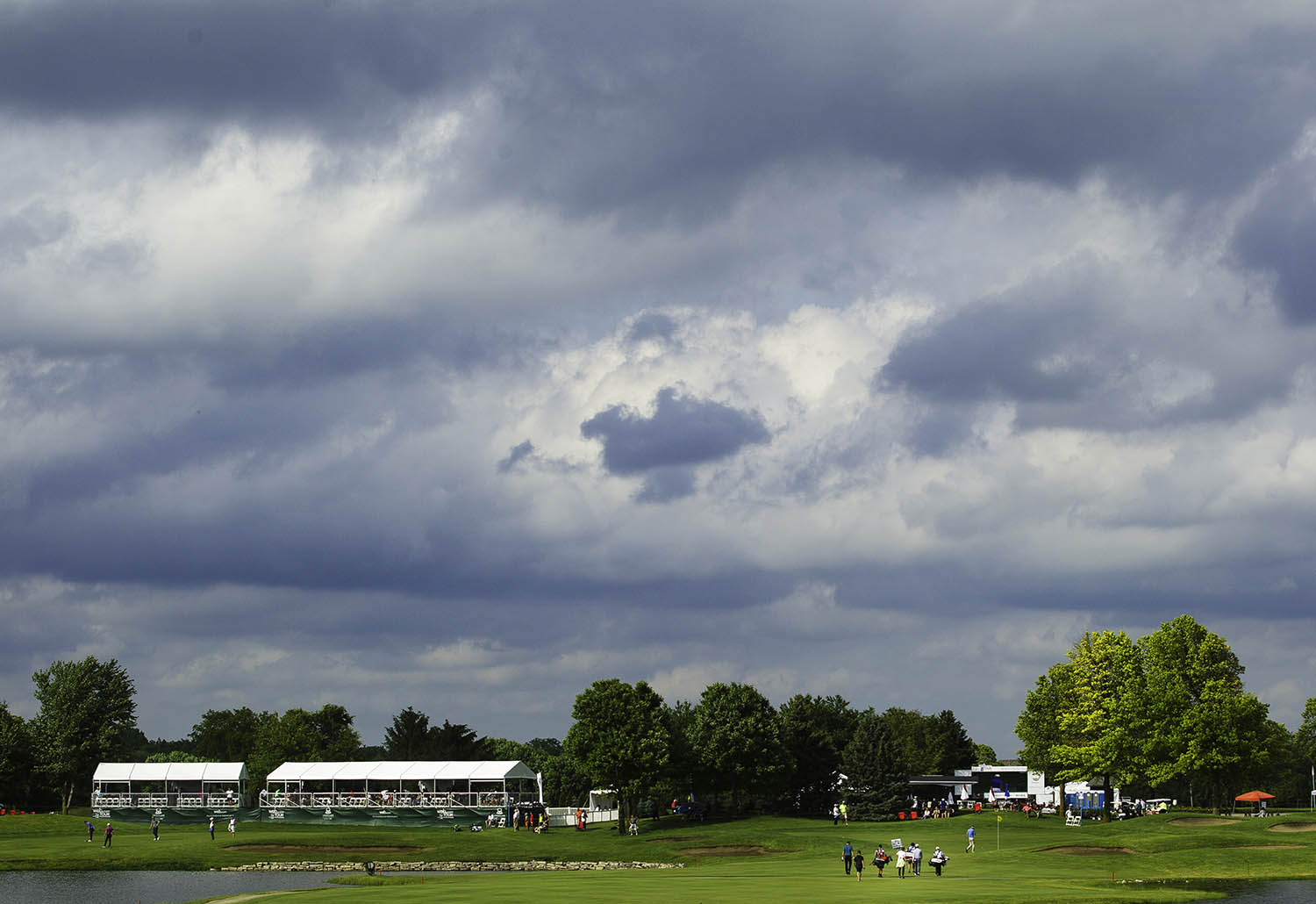 A group of golfers approaches the 9th green under dark skies during the third round of the Web.com Tour's Lincoln Land Championship presented by LRS at Panther Creek Country Club in Springfield, Ill., Saturday, June 15, 2019. Despite two inches of rain in the morning, the afternoon rounds stayed mostly dry.  [Ted Schurter/The State Journal-Register]
